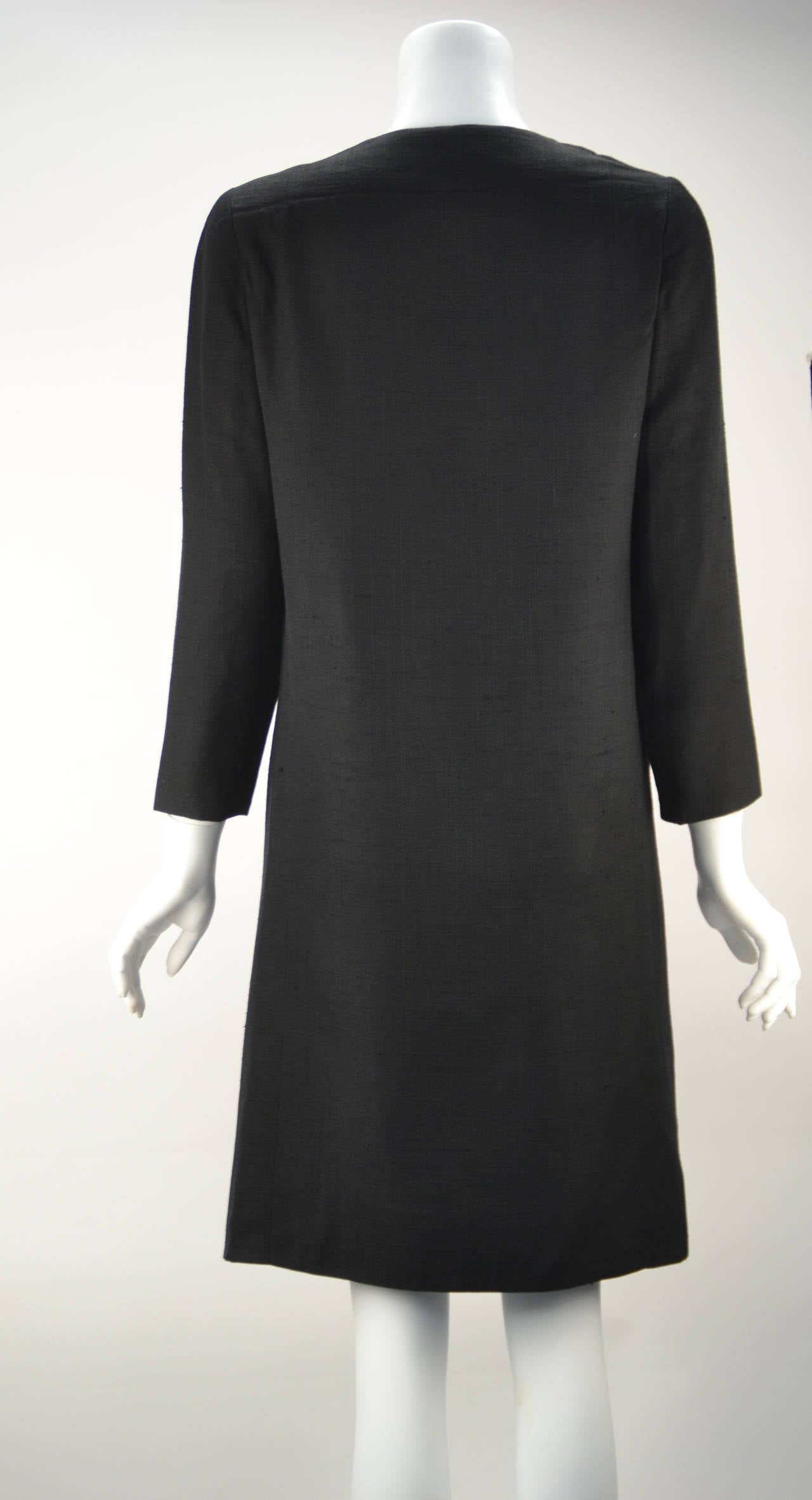 This 1960's Pierre Cardin dress is perfect for any occasion! Its brilliant design allows you to dress it up or down, wear it evening or night, or make it classic or mod!  Made of linger linen, the dress features a left side button closure and 2