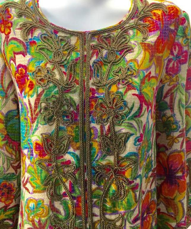 "Vintage Floral multi-colored embroidered Kaftan by Malouf Design.  Known as the maker of the ""perfect negligee"" Malouf design brought the Kaftan to the U.S. and allowed collector's of vintage to bring Malouf designs to day wear.    This"