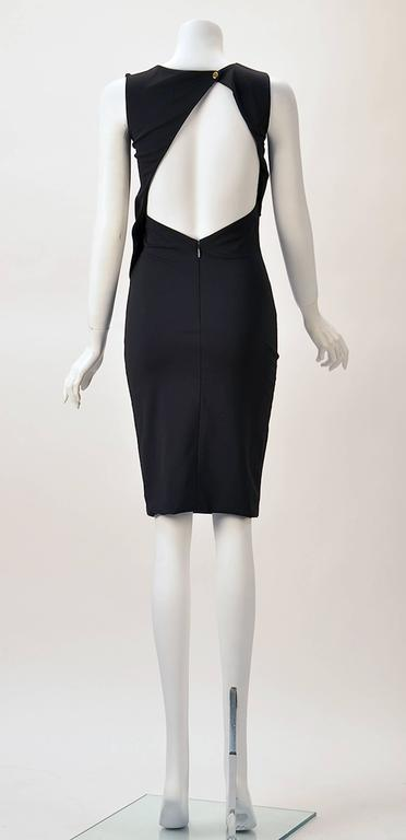 The Perfect LBD!  Sexy asymmetrical open back Gucci Black Knit Dress.  Day or night wear.  Dress it up or dress it down.  Day to night with a blazer by day and take it off for the evening.  Any time of year --unless you are in the Arctics.