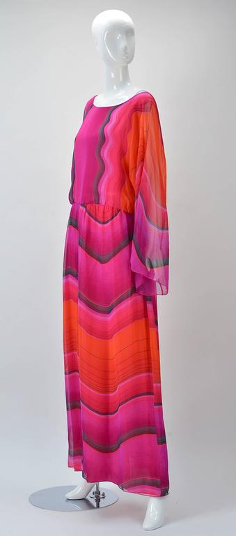 Hana Mori is known for her delicate silk dresses and this one is spectacular. The print could have been inspired by Red Rock Canyon in Nevada with reds pinks and grays. The length of the dress is maxi depending on your height. Extra long sleeves