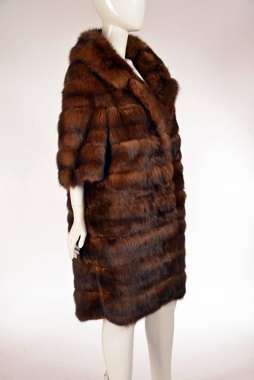 Unbelievable 1950s timeless Maximilian rich mink coat. Femininity is expressed in the details of the design with three quarter sleeves, knee length and it's large collar. Thoughtful design with horizontal stripes and cut creating a lovely