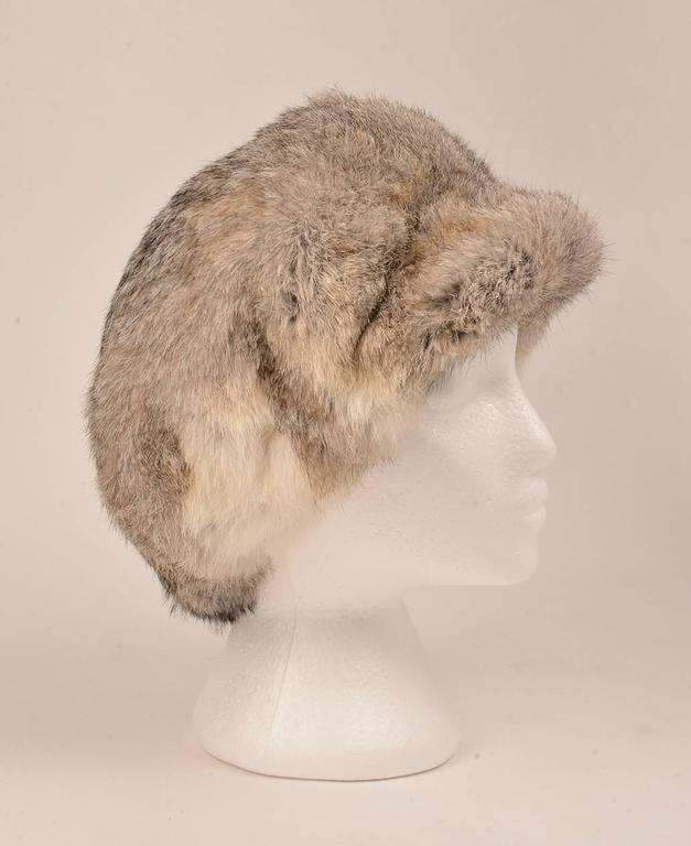 Vintage 1960s Adolfo II hat. This plush hat is made of rabbit fur, and features a bill to protect the wearer's eyes from the sun. The gorgeous, sumptuous fur is extremely soft, and is long enough to keep the head and ears warm. The fur exhibits a