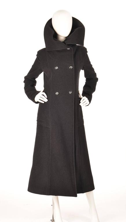 Vintage Ivan Grundahal Double Breasted Princess Seam Coat  Dramatic black double breasted princess seam coat by Ivan Grundahal. The coat features a fold-able, large stand collar to help keep you warm and fabulous on those cold, windy days. Two