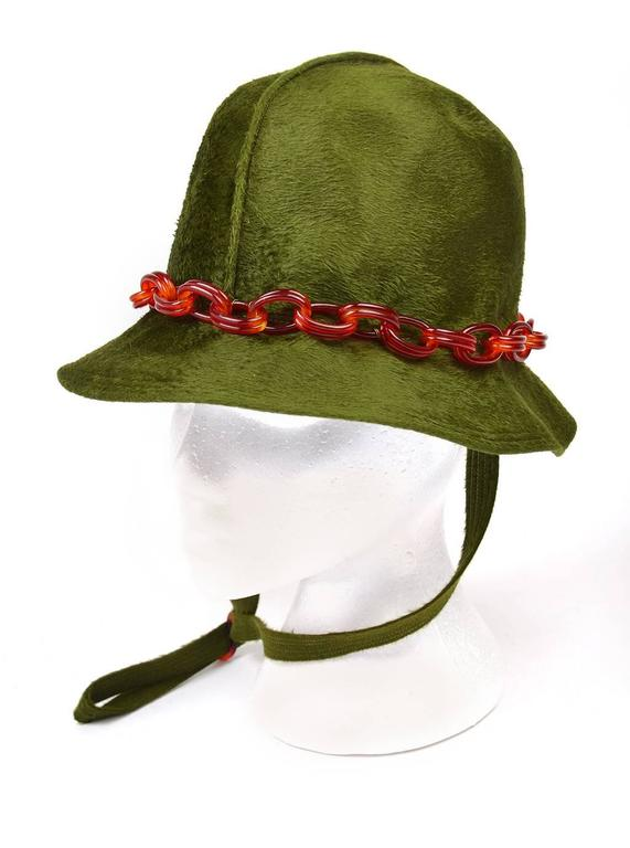 Funky 1970s Mr John Jr Trevi bucket hat. This wide-brimmed hat is accented with a stitch ridge running front to back, a well as a tortoiseshell oval link Lucite chain band, and a tortoiseshell Lucite neck toggle. The hat is soft and sleek, and