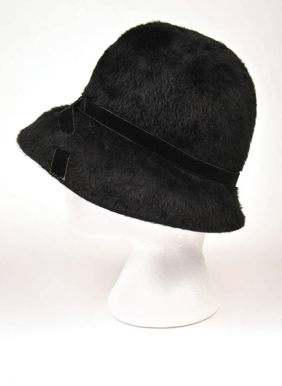 So Now!  Looks like it just walked off the Marc Jacobs runway show at New York Fashion Week.  This fantastic, wide-brimmed, soft and sumptuous faux fur cloche hat by Mr. John - Matador features an elegant velvet ribbon band that crosses over in the