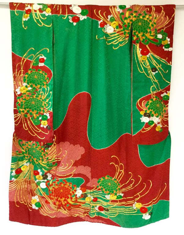 Absolutely striking! The Uchikake kimono is a formal kimono coat work worn only by brides or by stage performers.   This particular piece could have served as either a wedding kimono or a performance kimono because of its color and motif. This