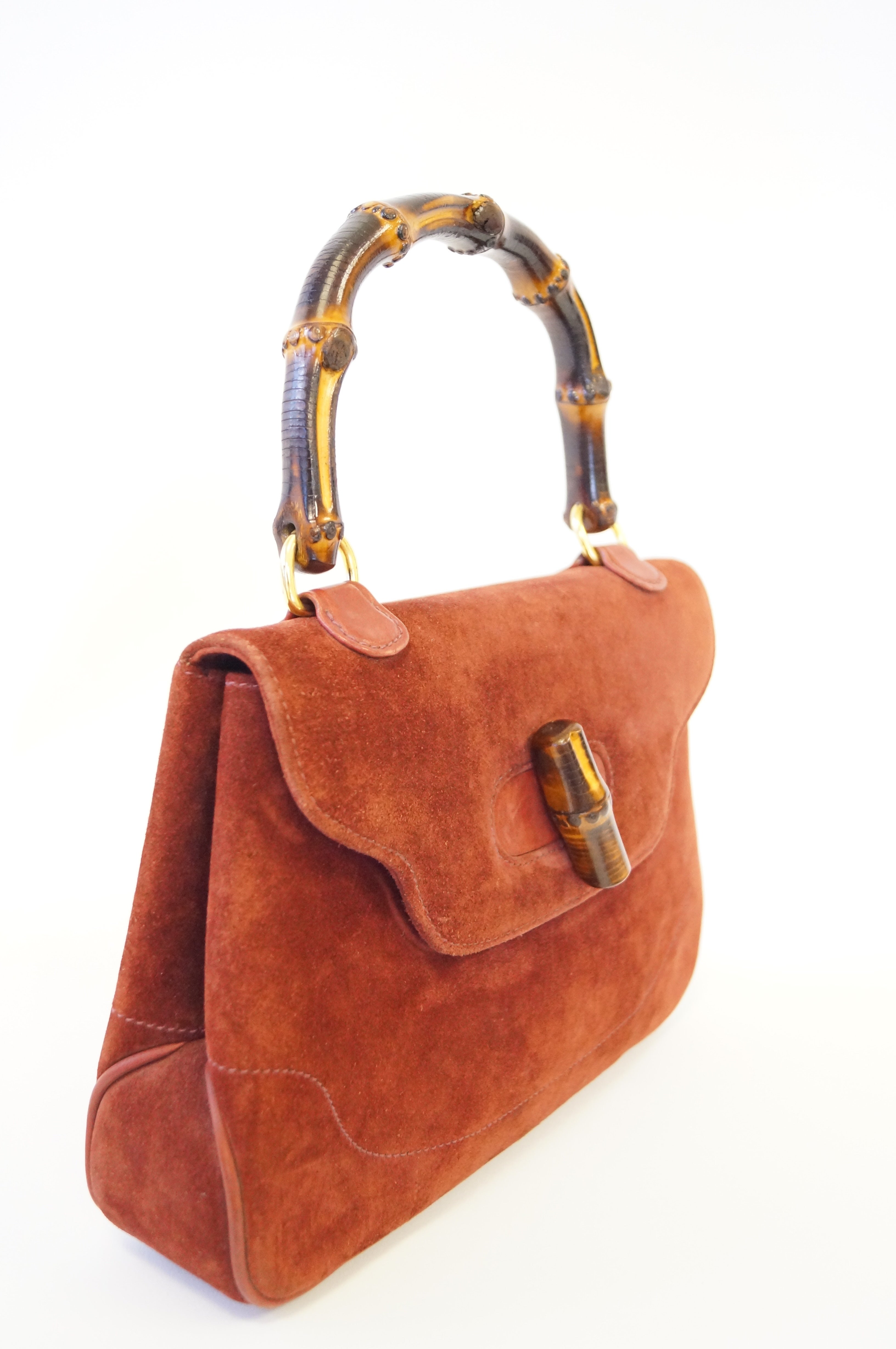 4b78f747ef7e Gucci Rust Colored Suede and Bamboo Purse, 1960s For Sale at 1stdibs