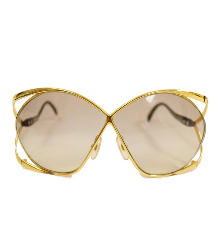 Iconic 1980s Dior butterfly sunglasses! These glamorous, feminine sunglasses showcase Dior's famous butterfly design. The apple green and gold-tone frames gently wrap around the oversized lenses. The letters