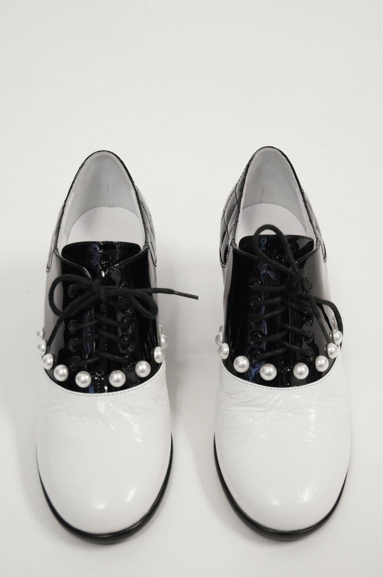 Iconic Chanel glossy patent leather black and white oxfords from the Pre-Fall 2014