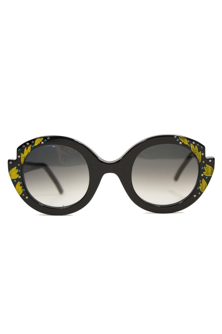 Limited Edition Frances Klein sunglasses!  Elegant and oversized circular floral glasses handmade and handpainted in France The glasses have large smoky rounded lenses with a black frame featuring notched details above where the temples connect to