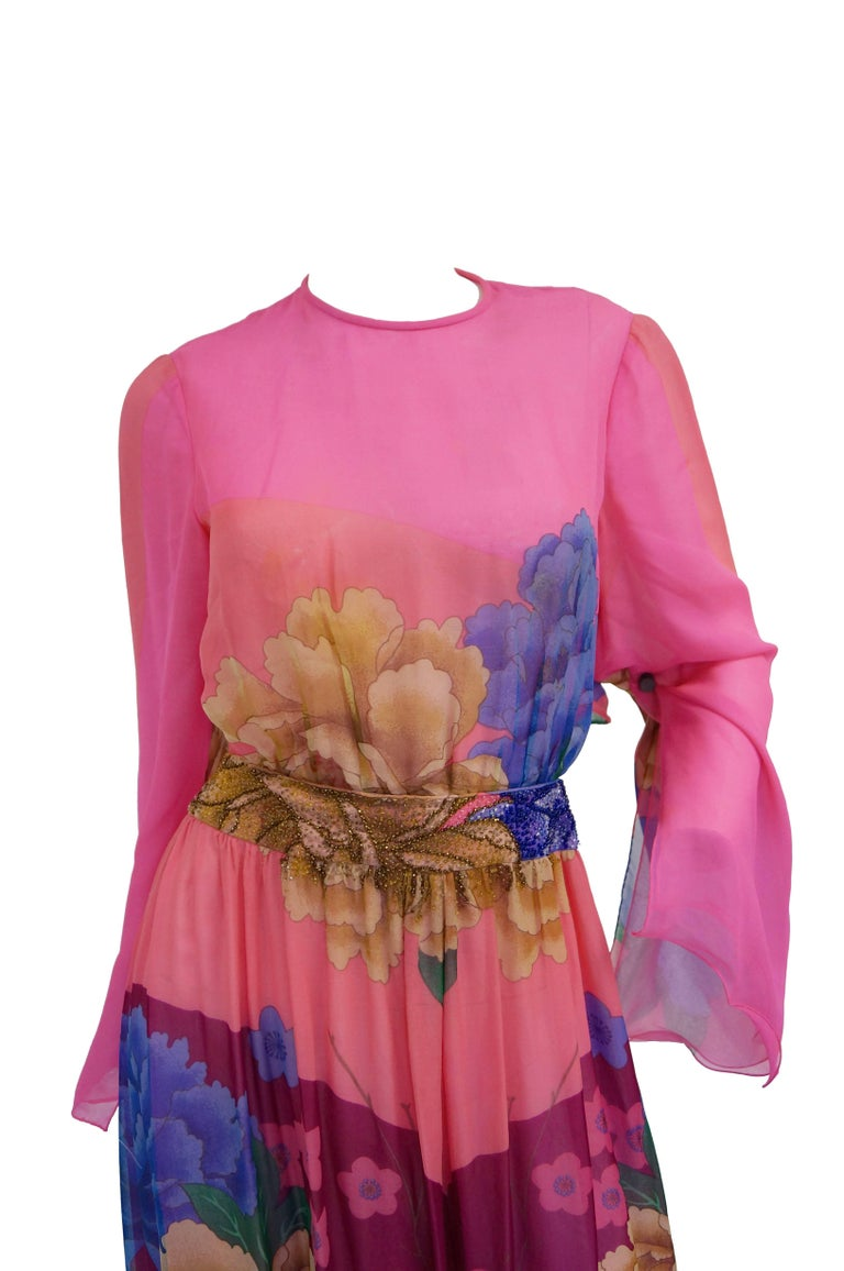Jumpsuit!  Yes, it is beautiful with a gorgeous Japanese style floral print on silk fabric in pink, blue, green, orange and beige. The waistline is beaded and coordinated colors match the print. Silk fabric is sheer and lined throughout. Long bell