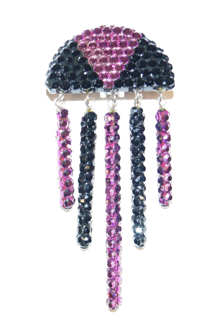 Wonderful '80s-does-'20s black and purple rhinestone earrings! The earrings feature a semicircle top divided into three sections of black and purple rhinestones. Five rigid rhinestone