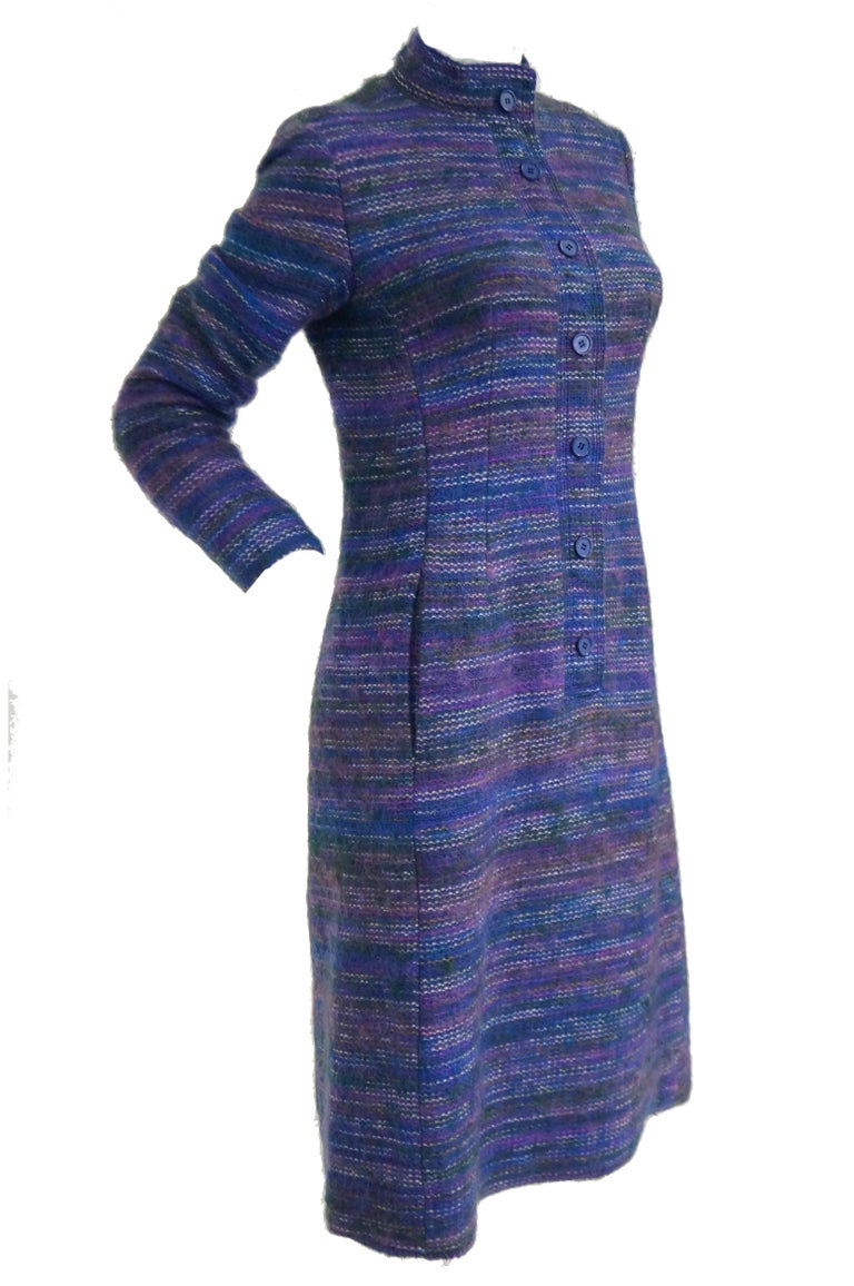 Wonderfully soft and supple angora wool dress by Givenchy! This shift dress falls below the knee, has long sleeves, and a mandarin collar. The dress has a long button closure from the collar to the hip, and has pockets. The fabric of the dress