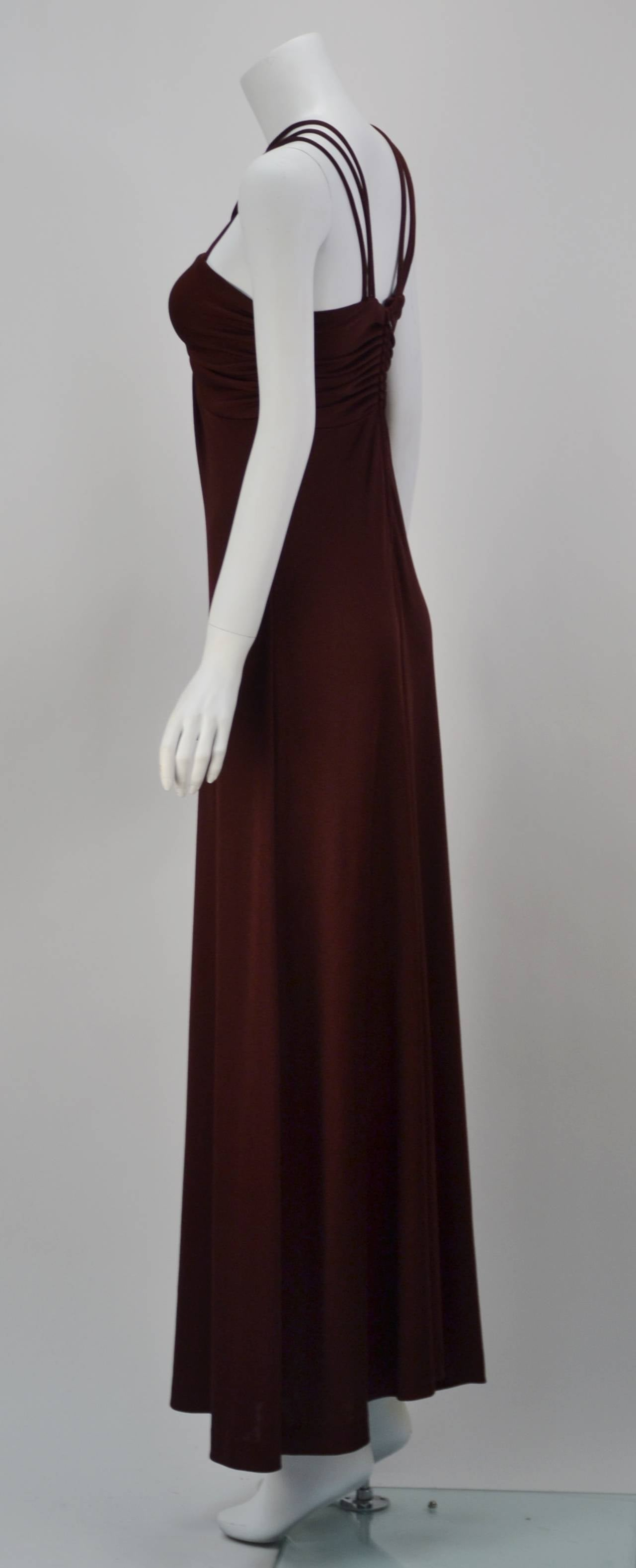 Unbelievably sexy and comfortable!  This Joy Stevens piece evokes studio 54 and the movie American Hustle, yet is so now with its simple fabric, simple cut, and it eco-friendly vintage use.  Made of a deep wine colored stretch knit that clings to
