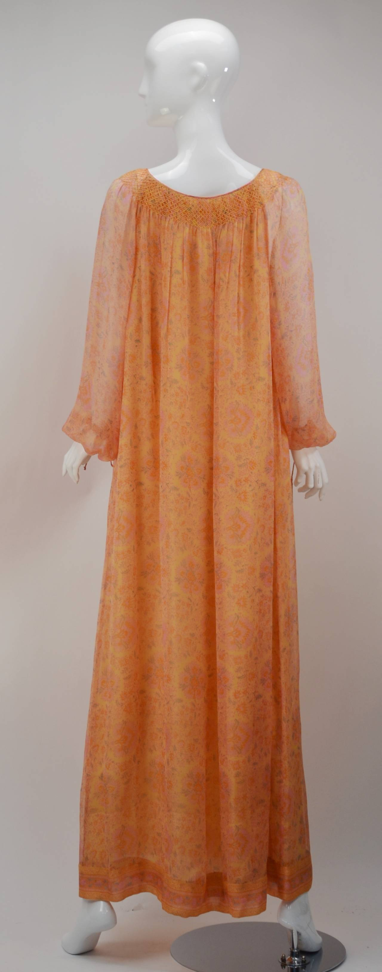 Vintage Treacy Lowe Spring colored, orange and peach silk chiffon peasant dress with beautiful floral print with small and light green leaves. Known for using tissue silk gauze with her custom designed prints, this piece serves as a perfect