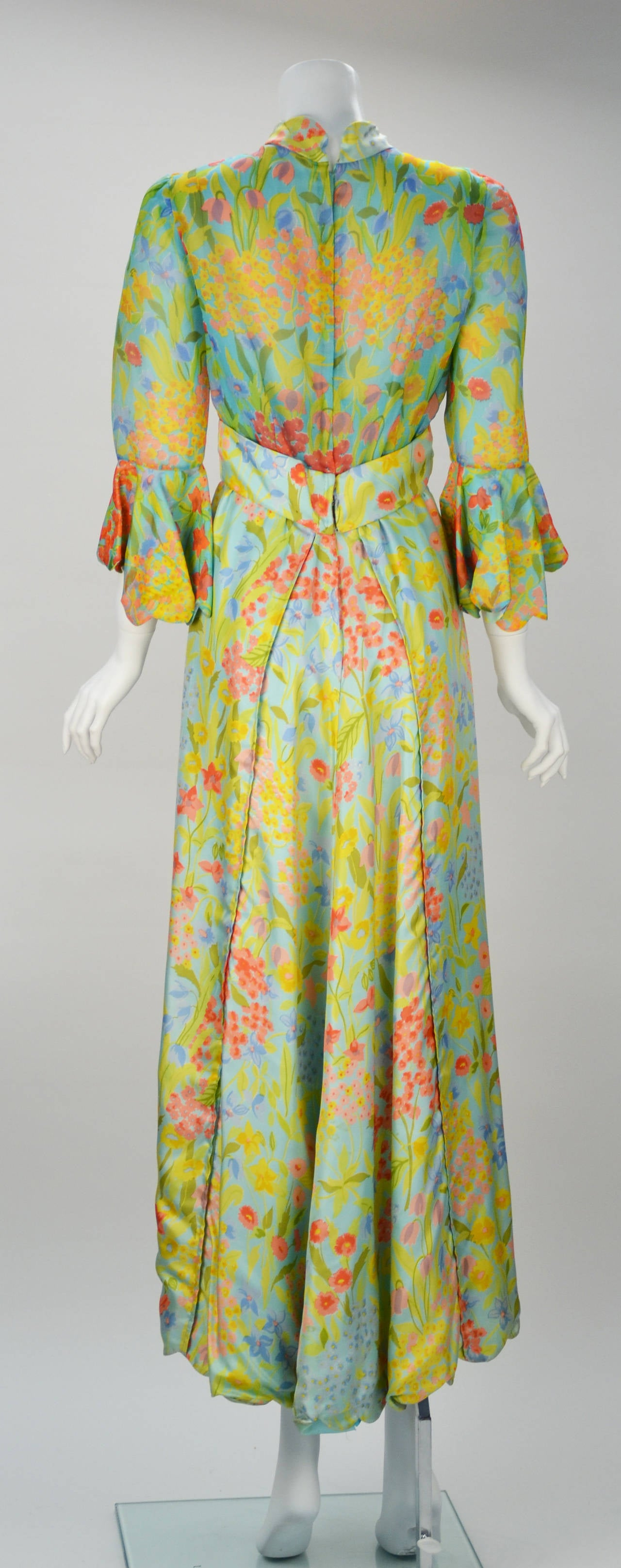 Tina Leser became famous for her international style. After graduating from art school she married and moved to Honolulu. This dress is definitely inspired by Hawaii with its floral print on sheer fabric and silky twill, possibly a Boussac Designer