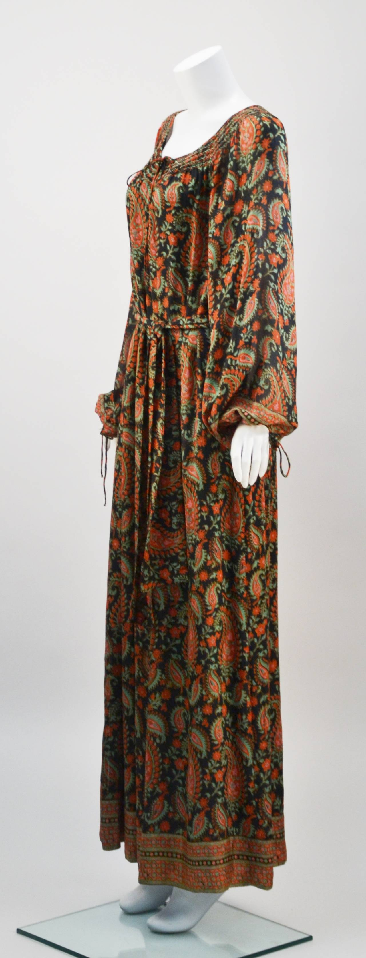 Wonderful Treacy Lowe Caftan dress is perfect for summer and wildly romantic, not to mention uber comfortable! Beautiful drape and design makes for a pretty dress. Scoop neck and blouson sleeves with ties at wrist. Almost floor length with a tie at