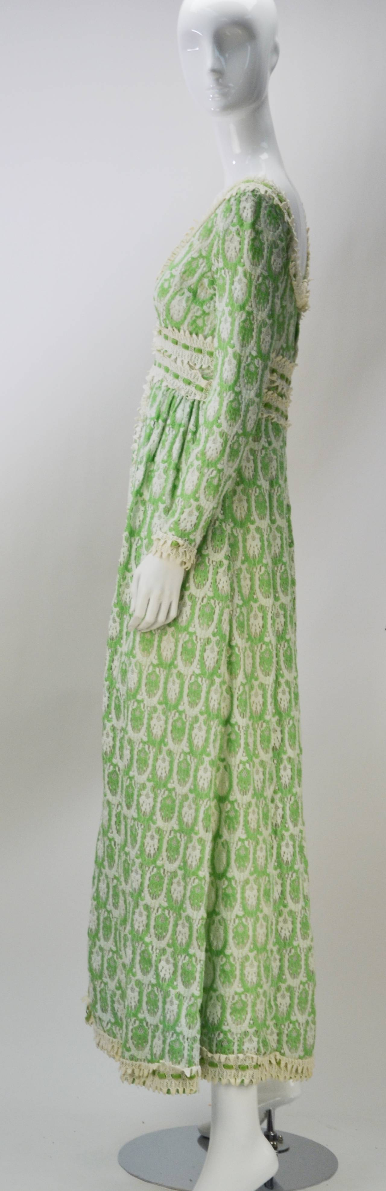 Channel some of your inner bohemian this summer with the fantastic 1970's White and Green open crochet knit lace dress with ribbon trim.  Crochet with velvet ribbon trim along the edges of the v-neckline, waistline, sleeve and skirt hems. The dress