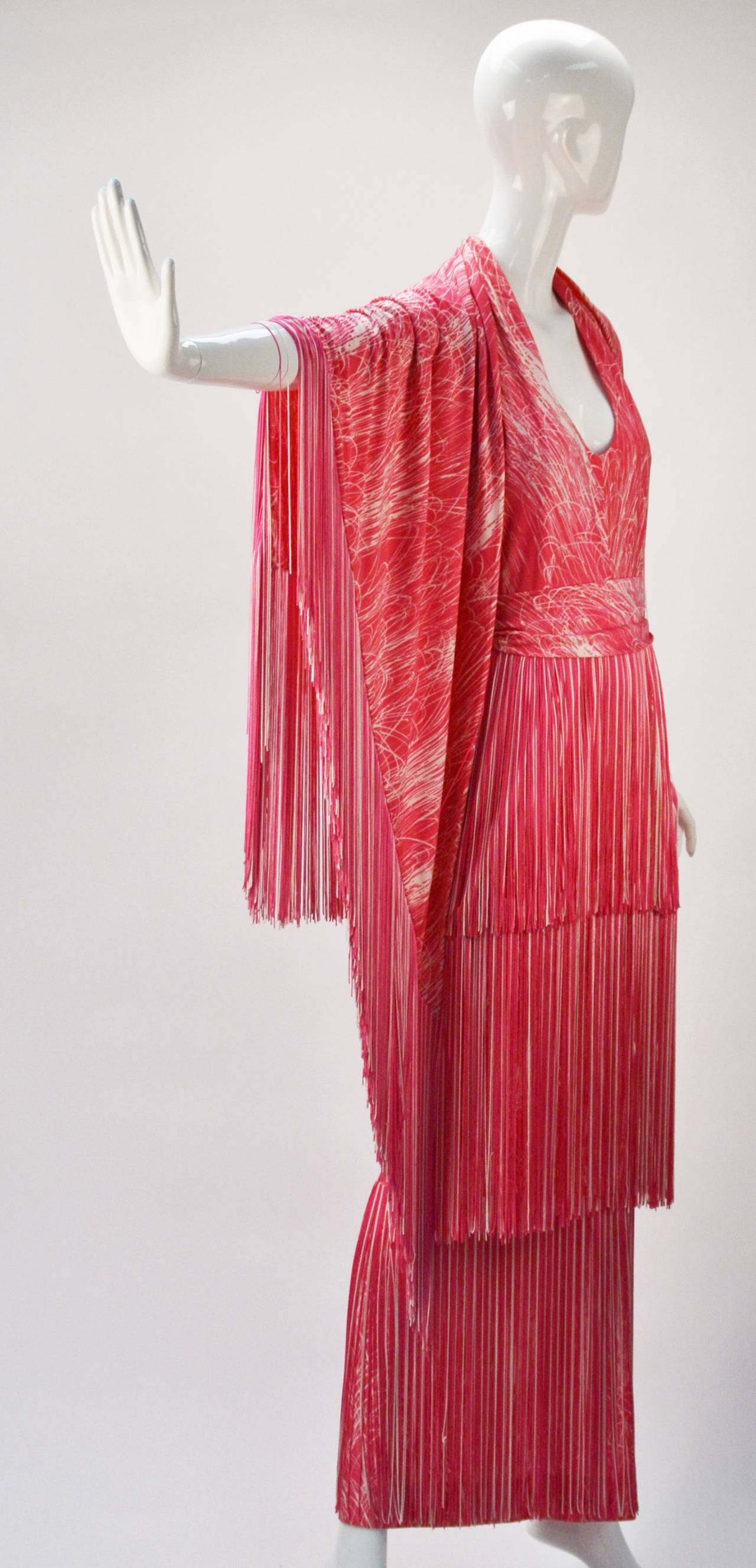 Sexy, stunning, and fun 1970's Lilli Diamond pink and white halter dress and shawl with fringe trim.  The halter neckline fastens at back neck with two hook-and-eyes, while also having a zipper fastener down the center back. There is a detachable