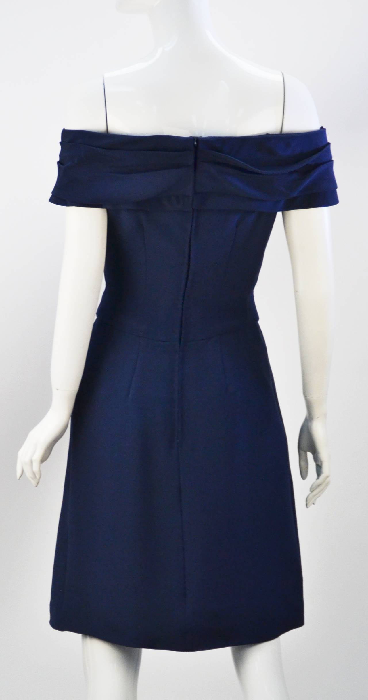 Absolutely beautiful vintage Scaasi navy silk crepe de chine dress!  Surprise front pockets hidden in front pleating.  Perfect bow accent at waist. Draped edge of shoulder or of shoulder neck line shows off beautiful décolleté. Interlined skirt.