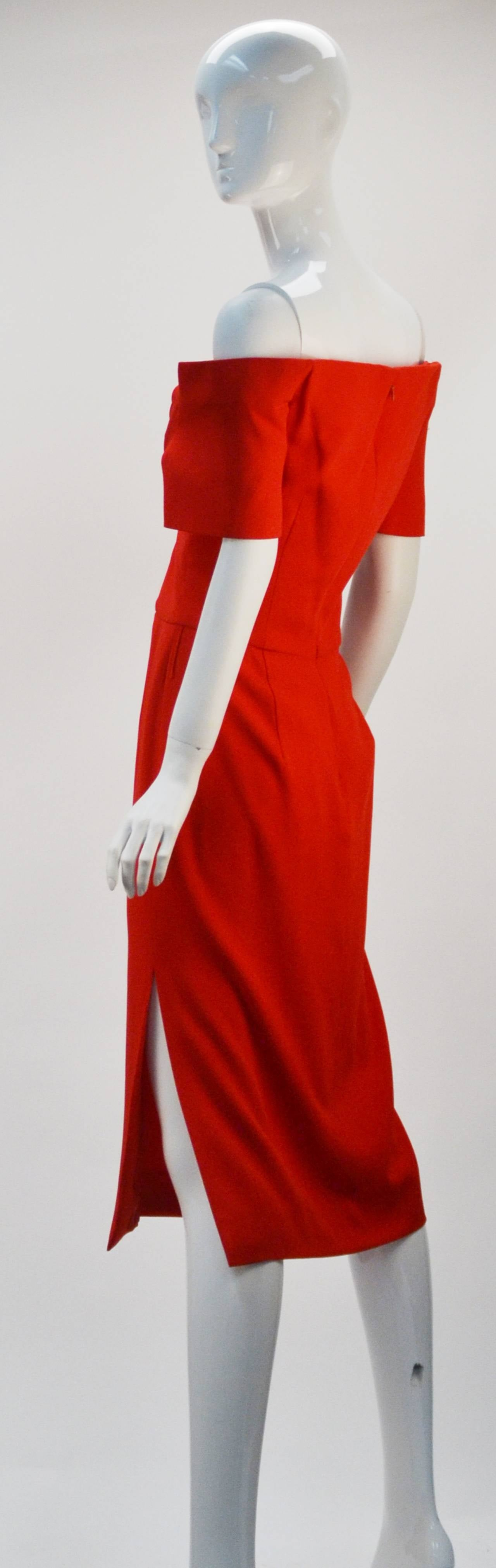 "1980's Scaasi off-shoulder red knee length dress. Elegance in silhouette and in simplicity.  Short sleeves, 13"" side slit and darting at the bust and waist add to the refined silhouette.  Wear with a blazer and pumps for a busy work day and"