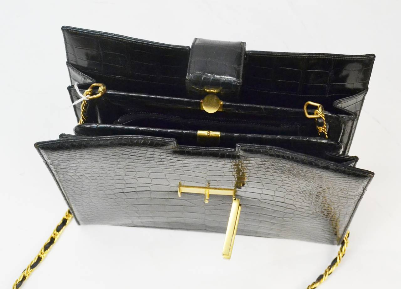 The Lucille de Paris brand was known for being one of the finest exotic skin handbag brands during the Mid Century. This Lucille de Paris alligator handbag has gold tone metal hardware. There are 2 slit compartments, with the main compartment that