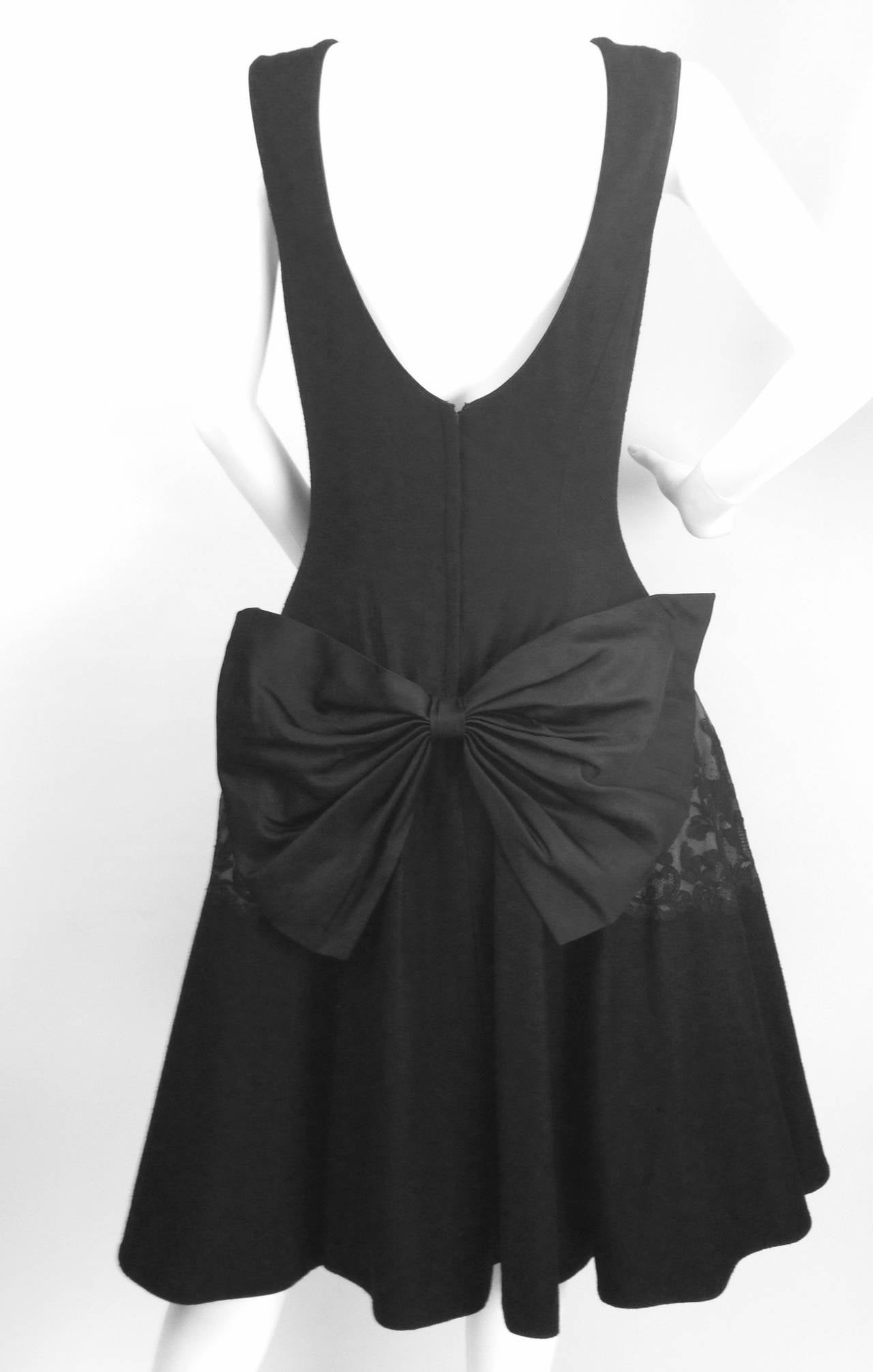 Stunning 1950's Mr. Blackwell Design can be worn as a formal evening dress or cocktail dress. Black wool with crepe lining under bodice and skirt underlined with interfacing for structure. Tulle petticoat. Features: scoop back, drop waist, Venetian