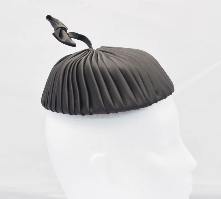 Fun and Fantastic, 1960's Miss Sally Victor black pleated pillbox style hat with springlike bow accent.  In excellent, possibly unworn condition.  Perfect for adding a bit of whimsy to your evening or adding a dash of drama to otherwise perfectly