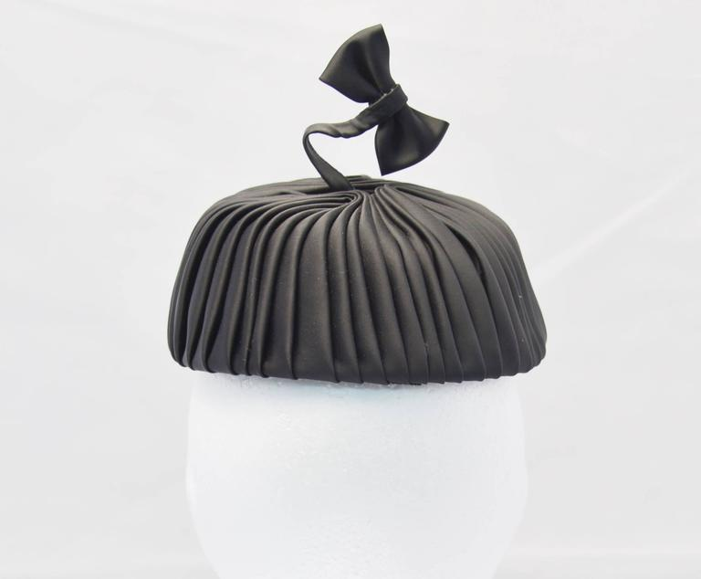 Gray 1960s Sally Victor Black Pleated Pillbox Style Hat with Bow Accent For Sale