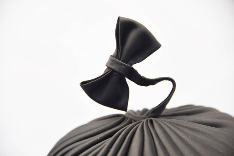 1960s Sally Victor Black Pleated Pillbox Style Hat with Bow Accent In Excellent Condition For Sale In Houston, TX