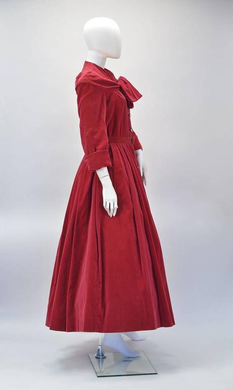 """Museum Quality fabulous velvet cranberry 1950's Christian Dior dress. This dress is the epitome of the """"New Look"""" recreated by Saint Laurent during his early years taking over the helm after Dior's sudden death.  While paying homage to his"""