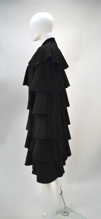 Extremely rare Gilbert Adrian work of art!!!   So few of this legendary designers works remain and of those that do, few are as flawless in their current state as this piece of wearable wonder.  Made of a beautiful black wool and professionally