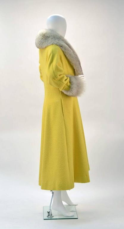 Bright and popular on our site his canary yellow wool coat is sure to brighten up your winter wardrobe! 
