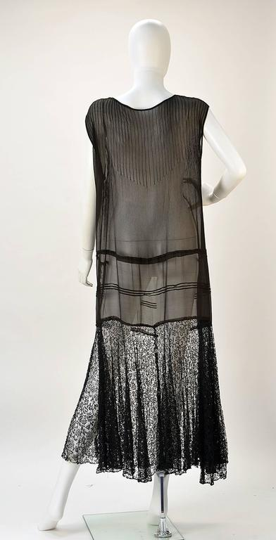 Delicate and wonderful, this sheer almost antique dress from the 1920's is a pure dream. 
