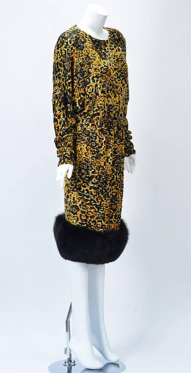 Bodacious 1980's yellow and black leopard silk burn out or Devore dress with Mink  hem by Bill Blass for Neiman Marcus. Thoughtfully embellished with black sequins and beading. Batwing type sleeves button at cuff. Five large black round buttons at
