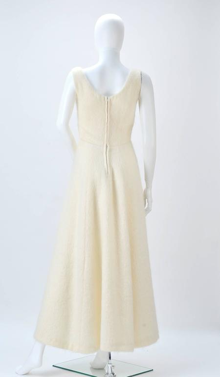 Gorgeous Winter White Mohair dress is simple luxury! An added bonus that it is warm and cozy as well! Fitted bodice to hip-line flaring into an A-line skirt. Making the silhouette a fit and flare. A blank pallet to style any way you wish. Zips at