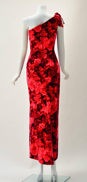 Stunning Betty Carol for Mam'Selle velvet red and pink floral dress. Off the shoulder with a matching folded bow. Dress is figure complementing in a fit and flare silhouette as well as a high low hem. Multi red color but not neon. Fabric seems to