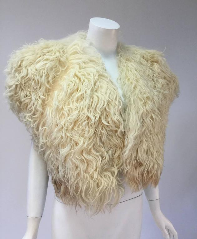 "Fantastic Courreges Paris cream karakul bolero.  Alluring ombre long fur from white to light brown, cropped, sleeveless, open front, L 18"", excellent.  Extremely soft to the touch.  No closures as the right side of jacket drapes perfectly over"