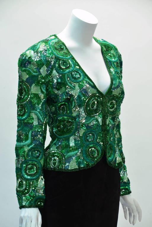 Festive Naeem Khan green sequin jacket created in the 1980's for his Riazee Line. Naeem Khan, known for his elaborate embellishment work, shows us how it is done with this jacket.  Embroidery and sequins throughout! Jacket has a plunging neck line