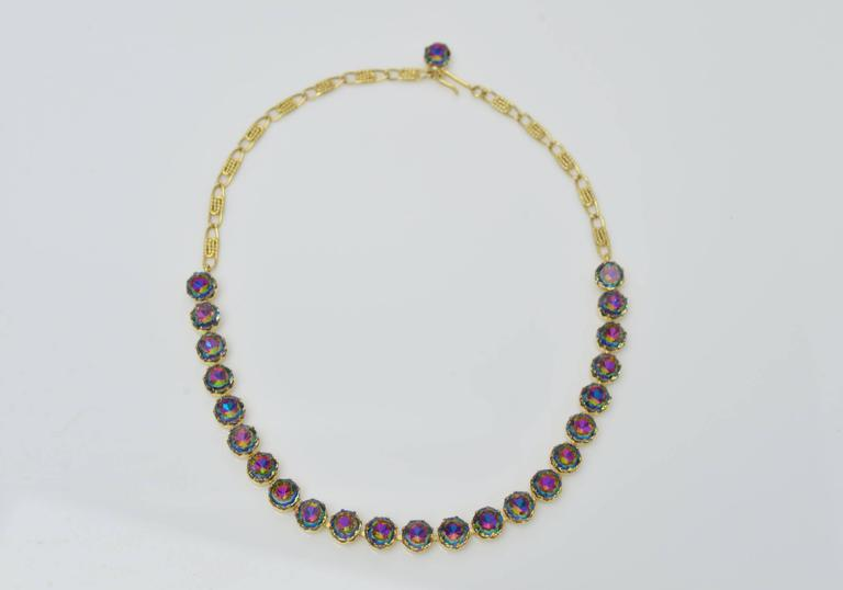 Unbelievable  and iconic Schiaparelli Watermelon Tourmaline colored Parure surviving from the mid 1950's consisting of 1 stamped necklace, 1 stamped bracelet & 1 stamped pair of clip earrings.Gold plated and prong set throughout. A phenomenal