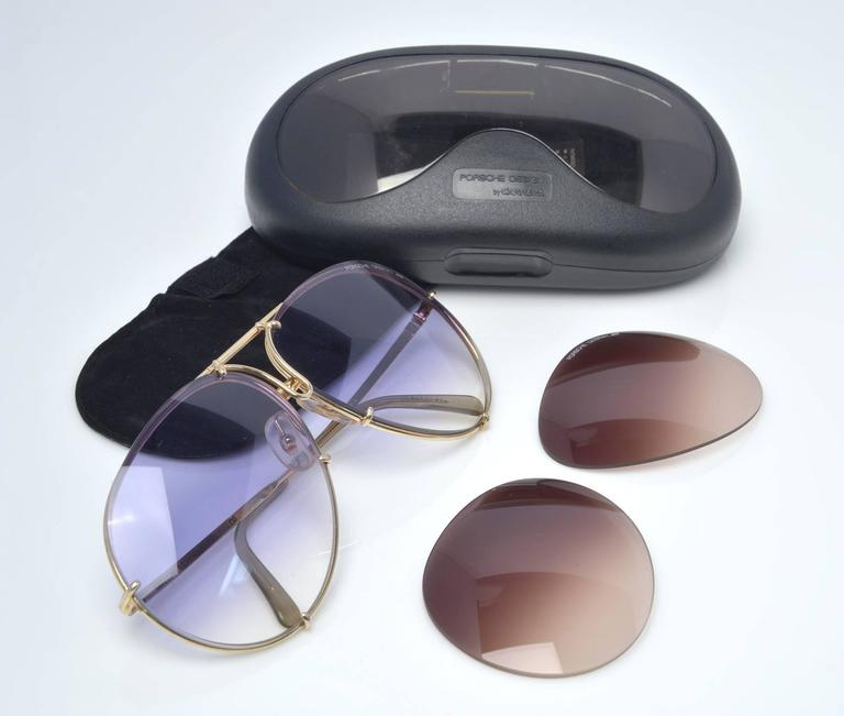 These classic 5621 Porsche design by Carrera sunglasses combine gold and silver titanium frames with a very rare blue gradient lens and come with a second set of brown gradient lenses which are quite rare as well.  1980's Porsche sunglasses were