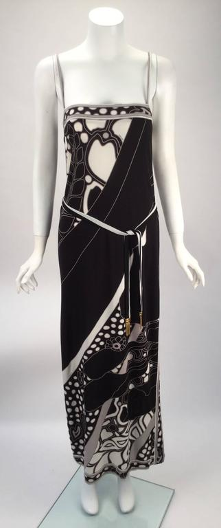 Said to have been inspired by the beautiful leopard moth this silk jersey knit spaghetti strap dress has a black and white print. Print design is highlighted with grey. Dress has a left split hem. Straight column silhouette. The jacket is originally