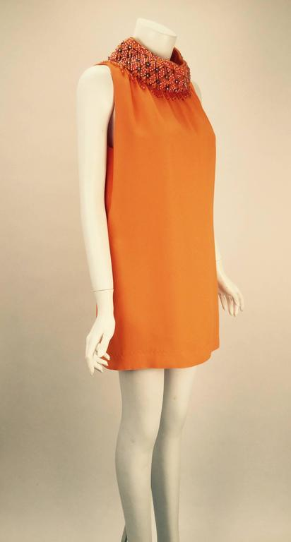 Fantastic and unique 1960s Gino Charles by Malcolm Starr orange ultra mini dress with a wonderful