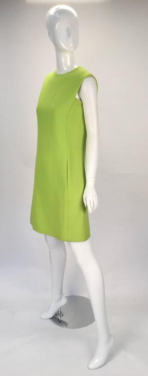 Absolutely radiant and fun, anytime of year or time of day, this 1960's lime green cotton blend sleeveless shift dress by the brand- Joan Leslie for Kasper is sure to brighten up your closet. There are two hidden side pockets. Dress is fully lined.