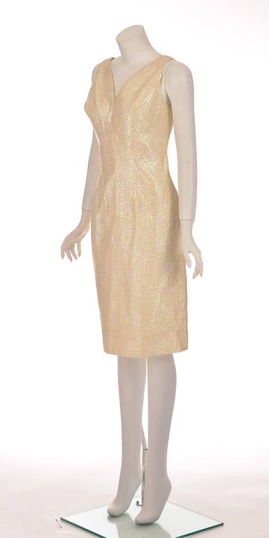 1970's California Brand Lilli Diamond cocktail dress. This gorgeous white pearl iridescent dress features an organic scale-like pattern that shines like a rainbow. The sleeveless dress has a deep V-neck in both the front and back, and has a center