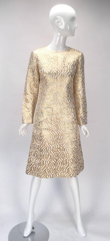 15027b3cd8 Vintage 1960s dress. This gorgeous cream and gold metallic brocade dress  features an abstract organic