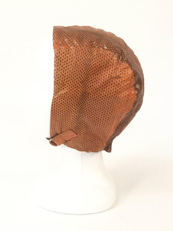 This fantastic  hat/cap made and sold at Neiman Marcus is an absolute delight! Reminds us of the helmet worn by Amelia Earhart in 1928 for her transatlantic journey.  Or it evokes a ride around the track by a Daisy Buchanan on a a newly introduced