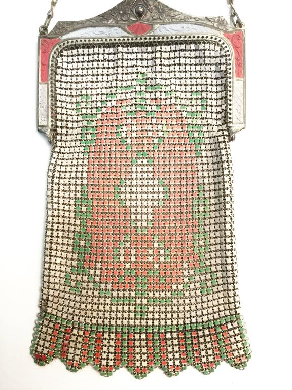 Delicate and dainty 1920s Whiting and Davis evening purse! This gorgeous enamel mesh purse features a pressed floral clasp painted in alternating springtime pink and white. The mesh body of the purse has a central pink, white, and green floral