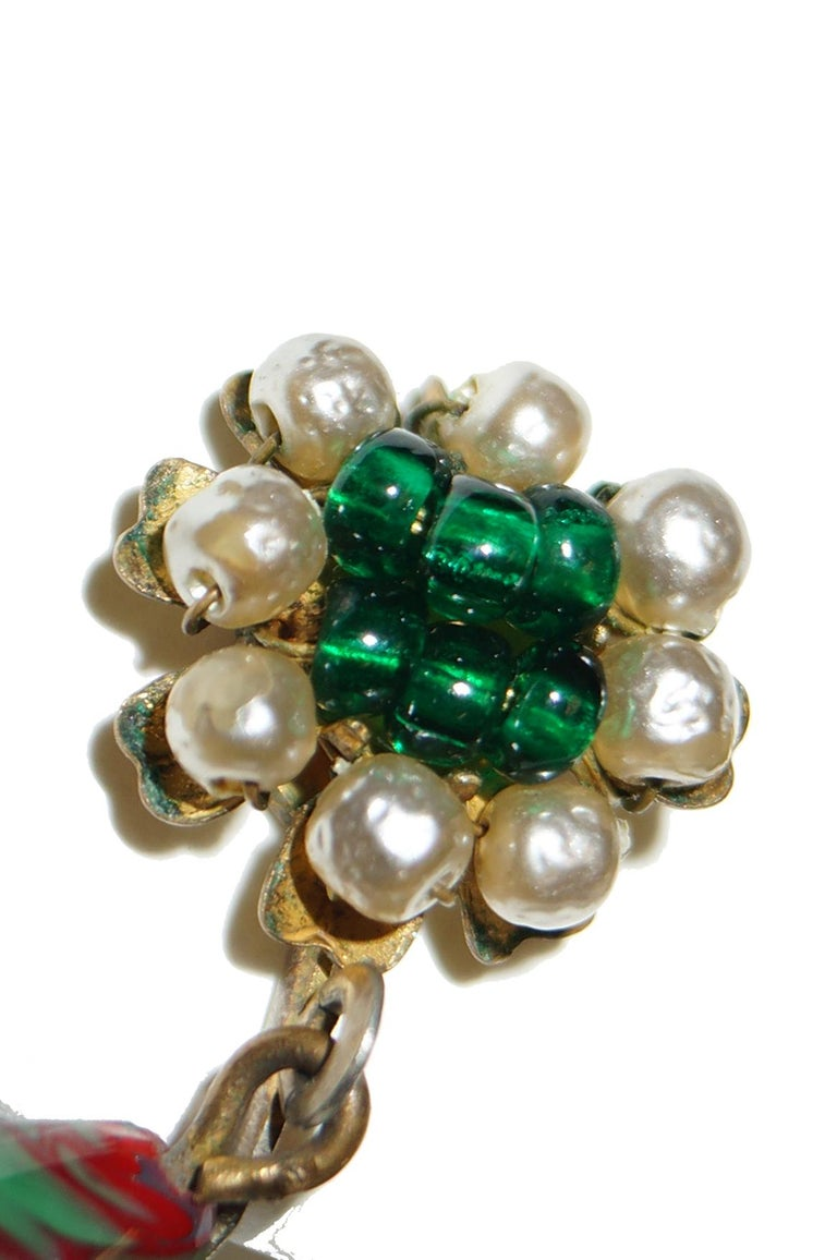 Beautiful drop earrings with poured glass tear bead in red and green. Sewn in baroque seed pearl and glass bead head. Screw back clip style with antique gold/brass tone hardware in typical Miriam Haskell style.