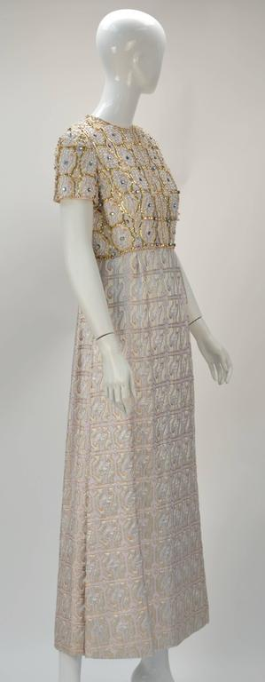 Graceful 1960's Gino Charles multi color with metallic gold brocade evening dress with sequins and beading. The label reads: